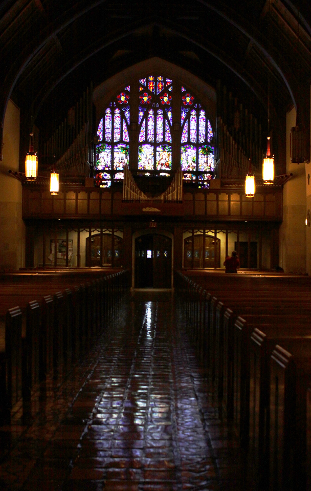 Here's the rear of the church. Notice the intricate stain glass window surrounded by the massive pipes from the organ.