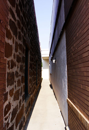 Like most small, rural buildings in downtown centers, there is no space between them. Here's the only gap in buildings I could find in the downtown area.