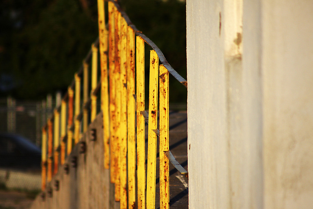 A fence in the rear of the grain silo in Ralston, Nebraska.