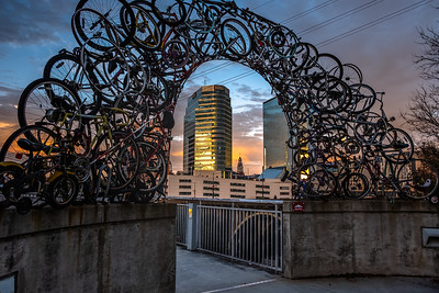 sunrise through the bike arch