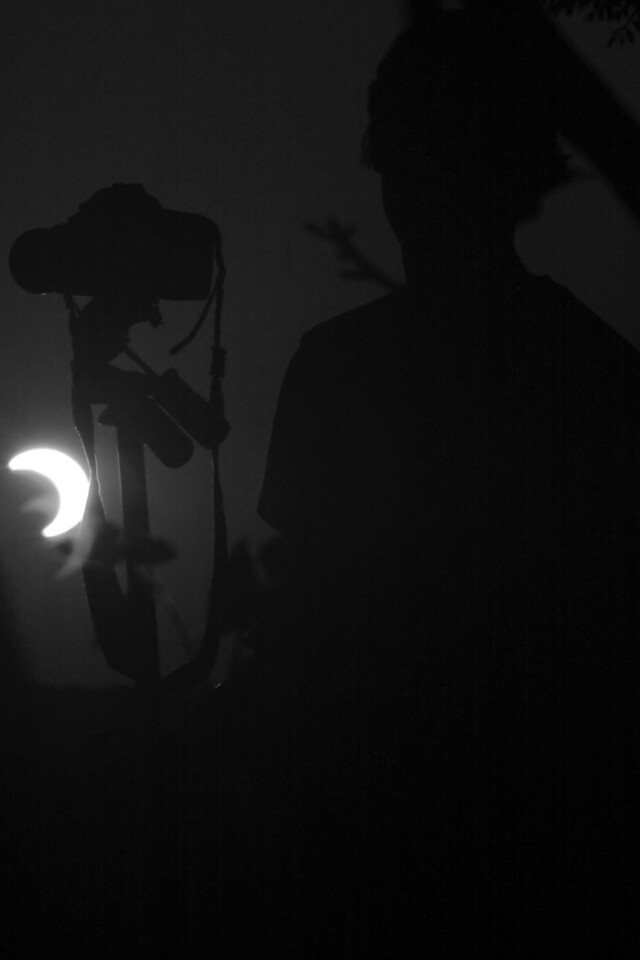 I photographed another photographer photographing the partial eclipse.