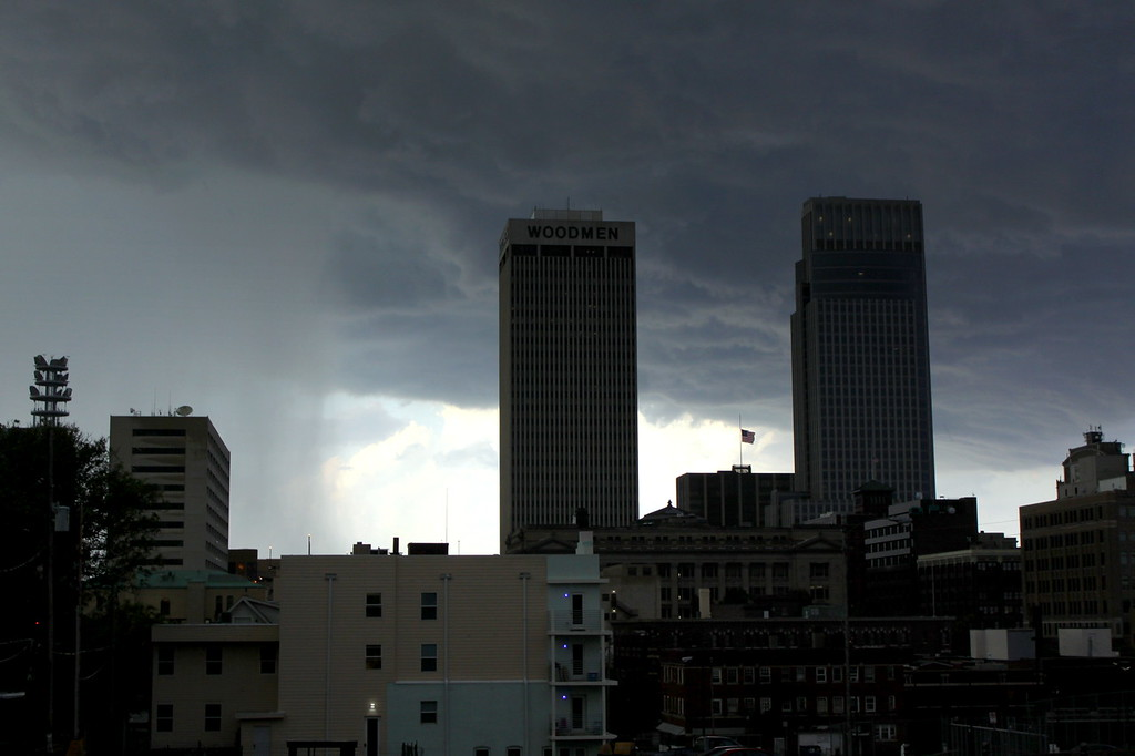 A wall of rain prepares to slam into the Woodmen Tower (left), and the First National Tower in downtown Omaha during the Midwest's worst drought in more than 50 years.
