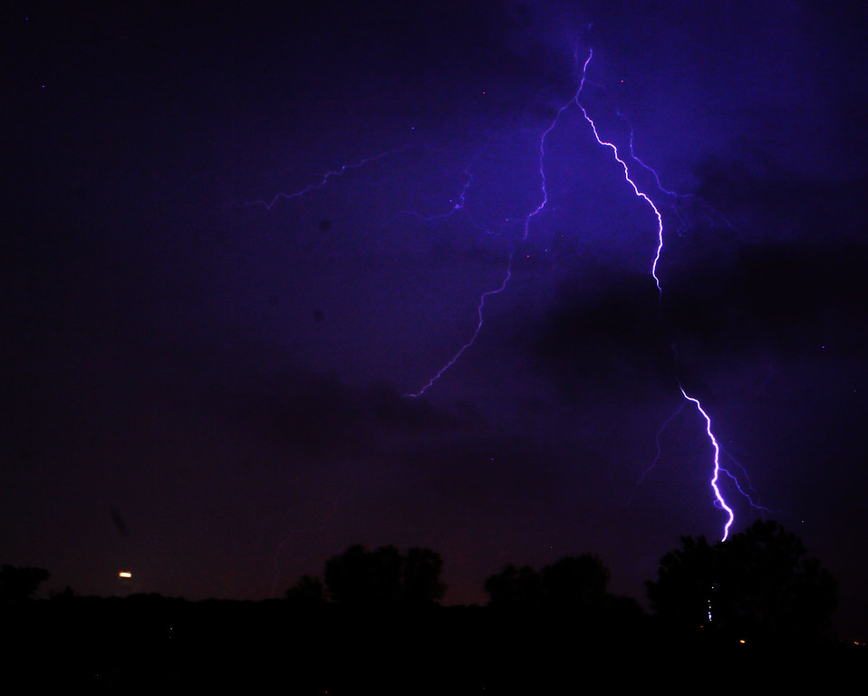 Here's a beautiful lightning bolt over downtown Omaha, NE., taken from Eppley Airfield.