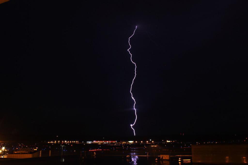 A perfect lightning bolt over the runway at Eppley Airfield in Omaha, Nebraska.