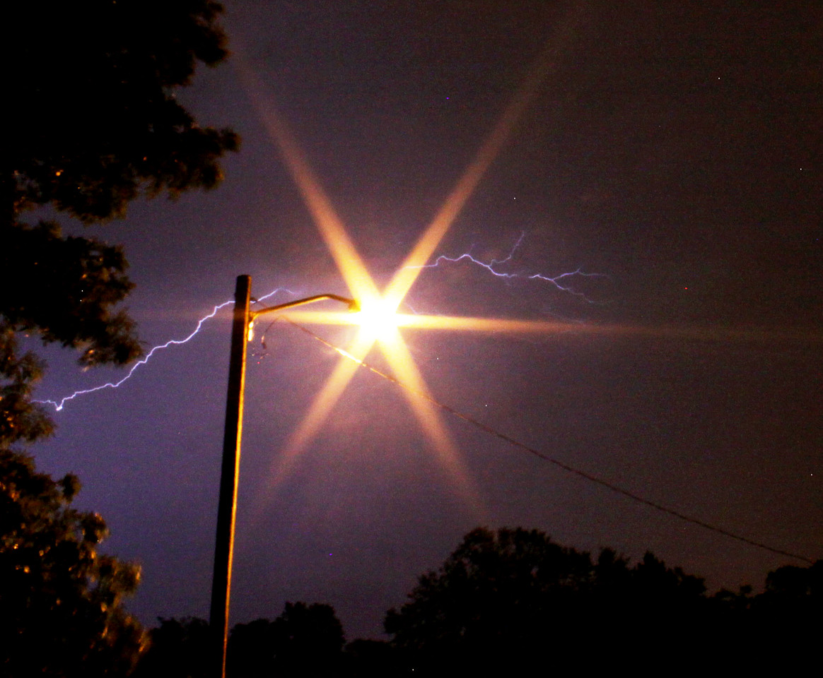 This is a lightning storm captured around 2 a.m. on May 2, 2012. There were multiple lightning strikes for almost an hour! Taken from my garage (because I'm not dumb enough to actually step outside with a large metal tripod) with a tripod and 18-55 with ISO 500 on F8 with shutter speed of 50