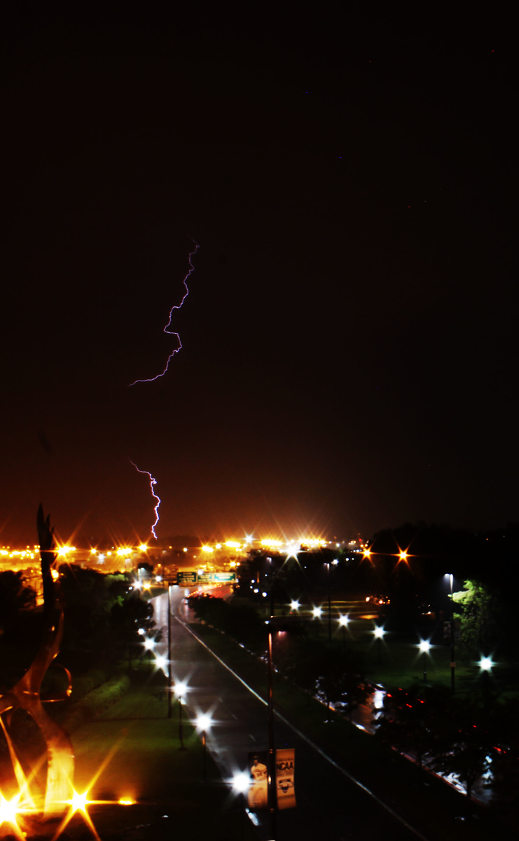 Some more lightning bolts and strikes in Omaha, Nebraska. Taken from Eppley Airfield, facing south.
