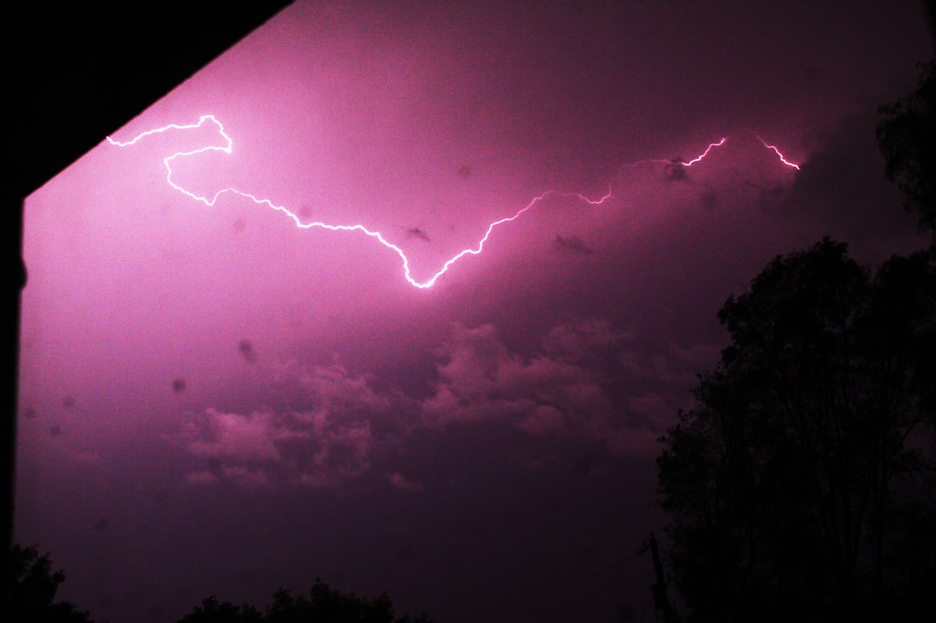 This is a lightning storm captured around 2 a.m. on May 2, 2012. There were multiple lightning strikes for almost an hour! Taken from my back door with a tripod and 18-55 with ISO 500 on F8 with shutter speed of 50