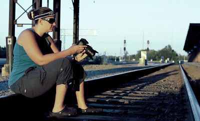 Heidi Brauer posing again on the railroad tracks outside of the old Burlington Northern building in downtown Omaha, Nebraska.