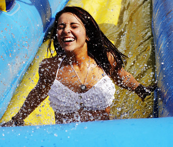 This is my niece, Kali, celebrating her graduation from Bellevue West High School today by going down the slip 'n slide in Bellevue, a suburb of Omaha, Nebraska