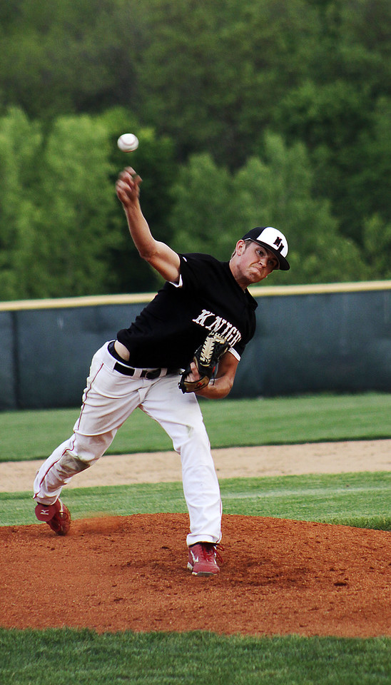 A pitcher from Mt. Michael High School throws in a game versus the Ralston (H.S.) Rams in Ralston, Nebraska.