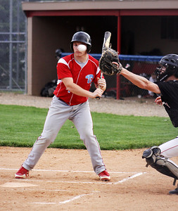 The pitcher for the Ralston Rams literally keeps his eye on the ball as it crosses the plate.