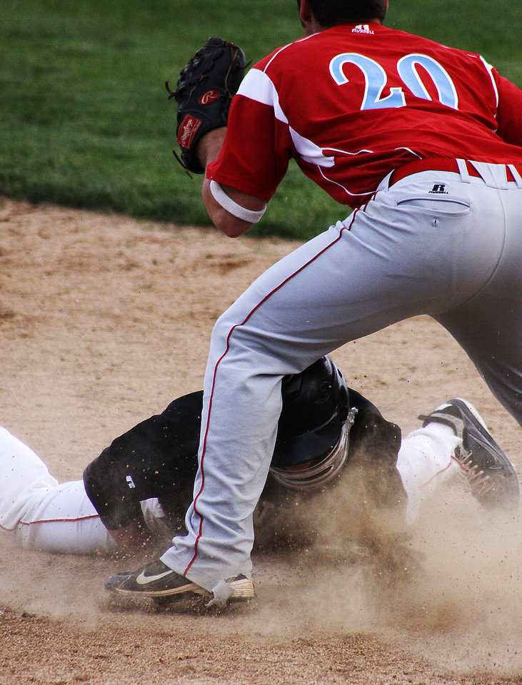 A runner for the Mt. Michael team beats the tag under the Ralston 3rd baseman.