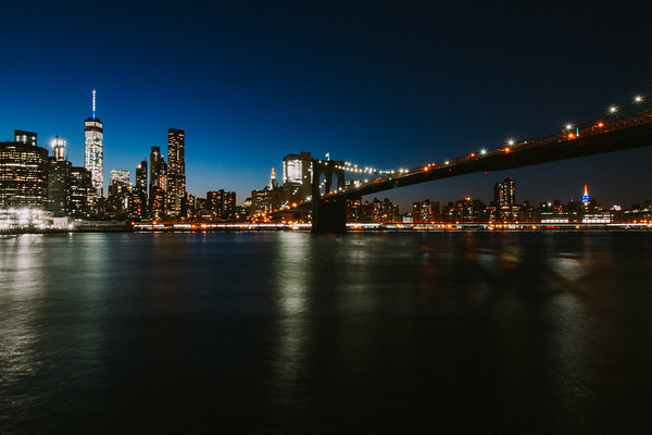 NYC Skyline at Nightime with World Trade Center and Brooklyn Bridge