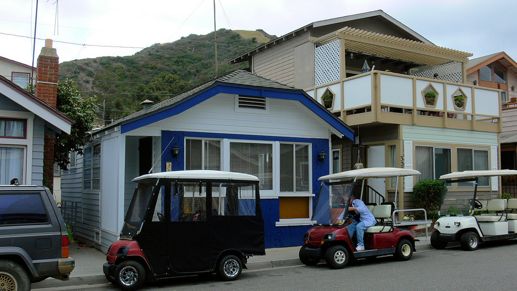 """The small 1930's bungalow in the center is where I along with friends and fellow photographers Ken and LaRee stayed while on Catalina. There are some regular-sized vehicles on the island but the most widely-used transportation in the one-square-mile Avalon are """"golf carts"""", but some are like none you'll ever see on a course..."""