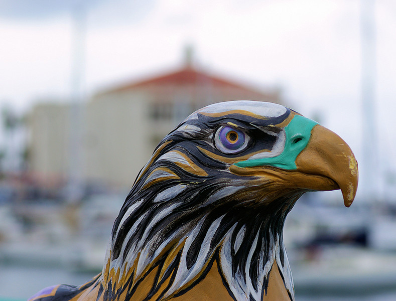"One of the hand-crafted ""statues"" along Avalon's harbor promenade in tribute to the Catalina Bald Eagles. The Casino is in the background."