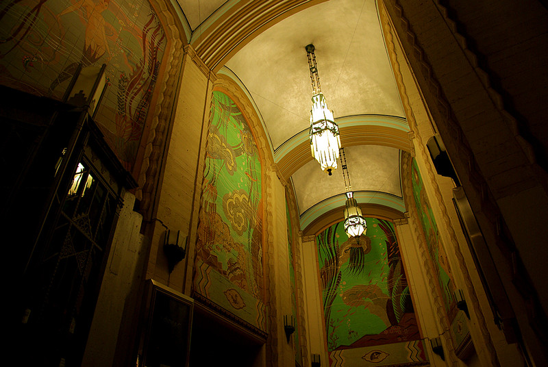 A night shot of the entrance area to the Casino showing the tiled murals from the 1930's.
