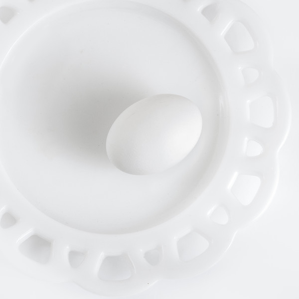 "Month 1:  Topic Minimalism<br /> <br /> Week 1:    ""The Incredible Egg: ""   I photographed this as a high key image.  I chose my old milk glass plate because I felt that the shapes within it worked well with the shape of the egg."