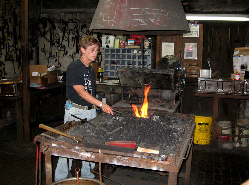 """""""You gotta love a woman with an anvil."""" - Buffy  The teacher of the blacksmith class this week was a woman (obviously).  The topic was repousse - or pressed designs in mental.  The stuff was SO COOL!"""