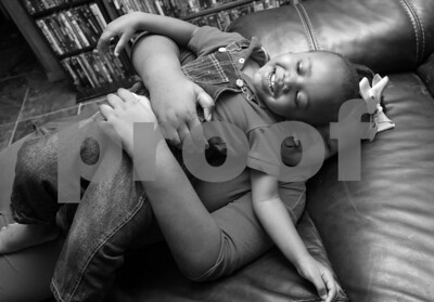 Erick Bradley's  children Bobbie, 9, and Jesse, 2, play in their living room at their house in Tyler Thursday Dec. 18, 2015. Bradley performs as rapper Jest-E and has a home recording studio.  (Sarah A. Miller/Tyler Morning Telegraph)