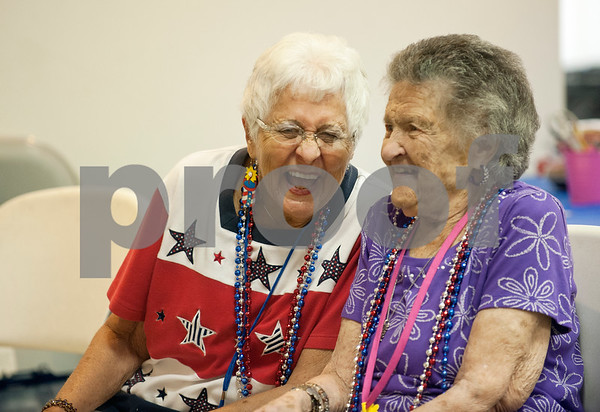 Participants Shirley Pearson and Julia Kucsan laugh and sing together during the Wonderful Wednesdays Day Club at Shiloh Road Church of Christ in Tyler Wednesday July 1, 2015. The program is part of the Alzheimer's Alliance of Smith County and provides social and cognitive stimulation as well as lunch for people with Alzheimer's disease or dementia. (photo by Sarah A. Miller/Tyler Morning Telegraph)SMIL/Sarah A Miller  (photo by Sarah A. Miller/Tyler Morning Telegraph)