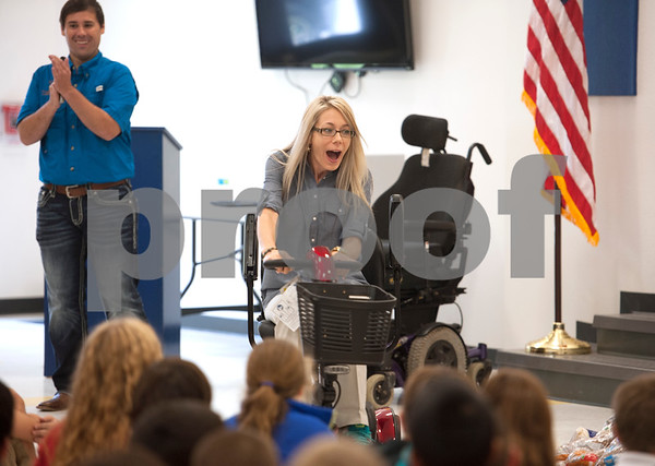 """Christi Wyatt Zimmerman, 37, takes her first ride on a mobility chair at Cumberland Academy Middle School Sept. 19, 2014. Two of Zimmerman's children attend the school which raised money for the chair that she would need once her ALS progressed and weekend the muscles in her legs. The chair is now affectionately called """"Scoot.""""  (Sarah A. Miller/Tyler Morning Telegraph)"""