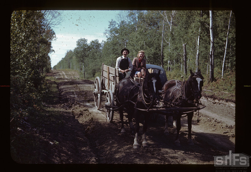A. H. Neilly - store keeper and Dottie Charlton on Saskatoon Settlement Road. Loon Lake.  08/21/1944