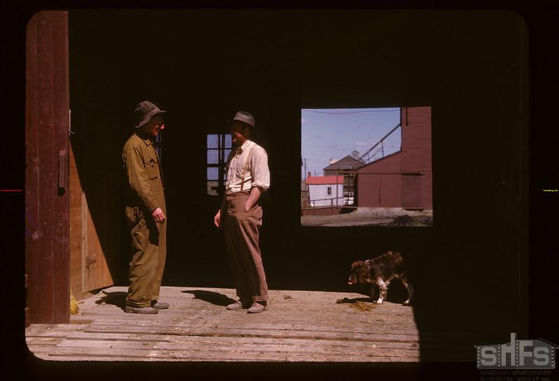 "Matt Brown & ""Chet"" Closs [at entrance to pool elevator] Gravelbourg 06/11/1947"