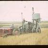 Wheat pool vice president Fen Sproule - co-op tractor and combine. Lafleche  08/29/1942