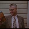 Alex Miller - Manager - holding sunflower seed oil. Altona. 05/16/1946