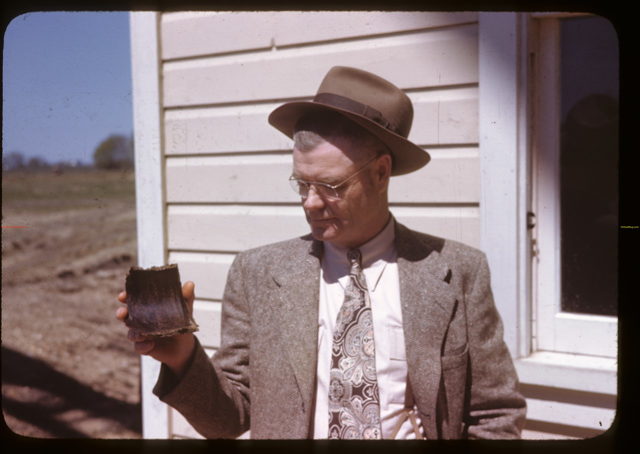 Alex Miller - manager - holding hardened sunflower oil cake.	 Altona.	 05/16/1946