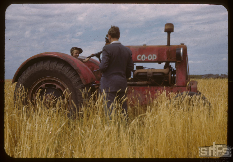 Marilyn Robinson and Leon Kofod with Co-op tractor.  Regina.  08/22/1943