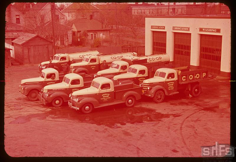 Sherwood Co-op truck fleet; 3 oil trucks - 3 coal trucks and 3 general delivery trucks.  Regina.  10/09/1947
