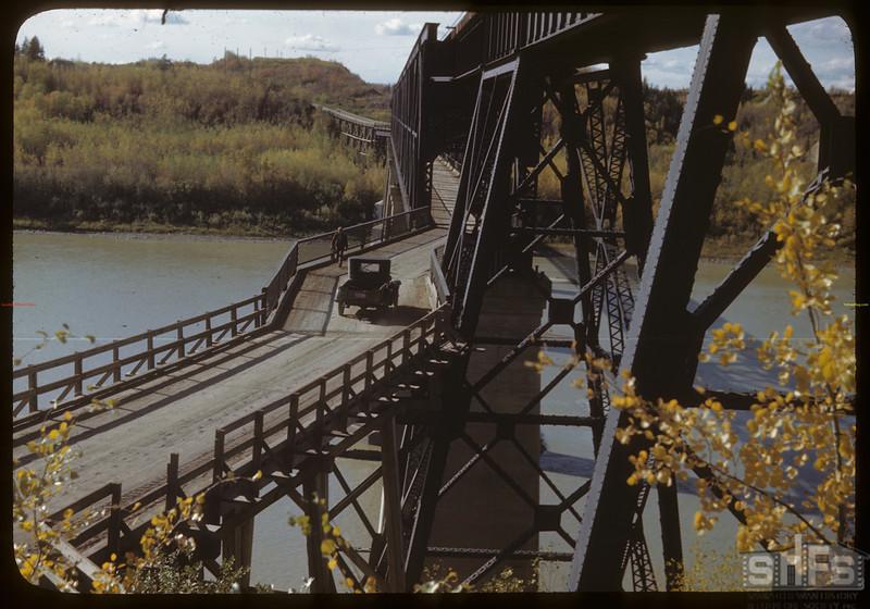 From Nipawin looking west across Saskatchewa River bridge. [bridge built in 1929]. Nipawin. 09/27/1946