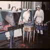 Co-op horse plant - packing in tins before cooking.	 Swift Current.	 07/03/1946