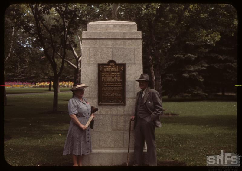 Mr & Mrs Z.M. Hamilton with plaque commemorating Sask creation as province - Victoria Park.  Regina.  08/23/1943