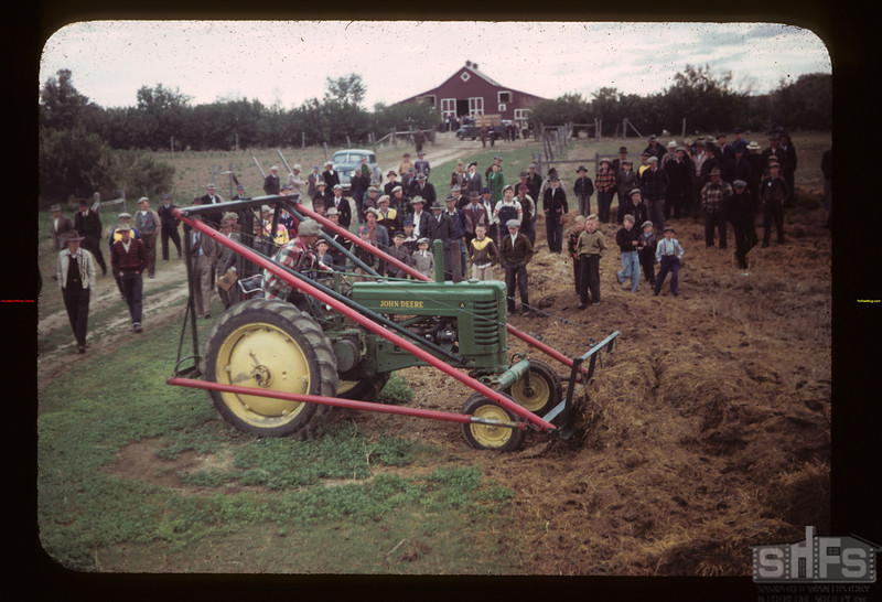 Demonstration tractor lift at Malcolm Mctaggart's	 Ferland	 06/17/1949