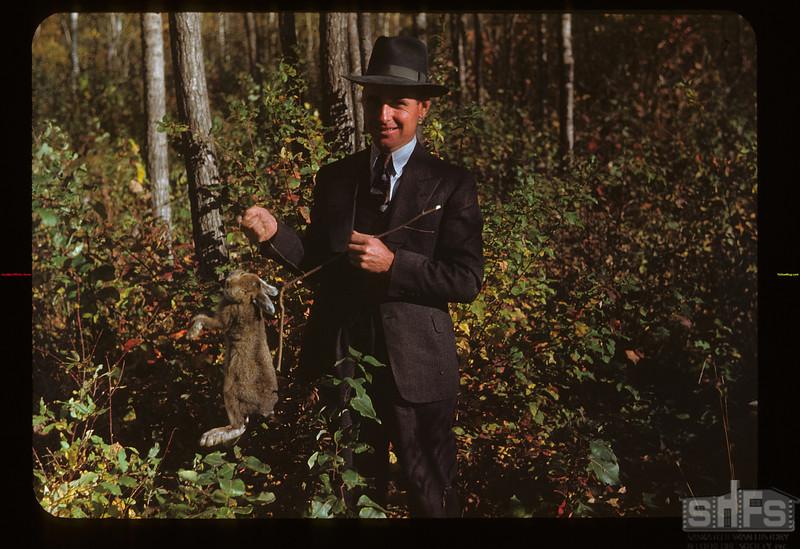 Bruce Buchanan Holding Indian snared rabbit Loon Lake 10/02/1948