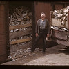 Hugh Trask loading bones to be shipped to Louisiana to make Glycerine & glue & etc. Frenchman Butte. 06/19/1941