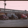 Trucks unloading Livestock Pool stock yards - west side.  Regina.  10/22/1946