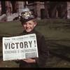"""Paper declaring """"Victory"""" held by George Baker 1837 McAra Street. Regina 05/07/1945"""