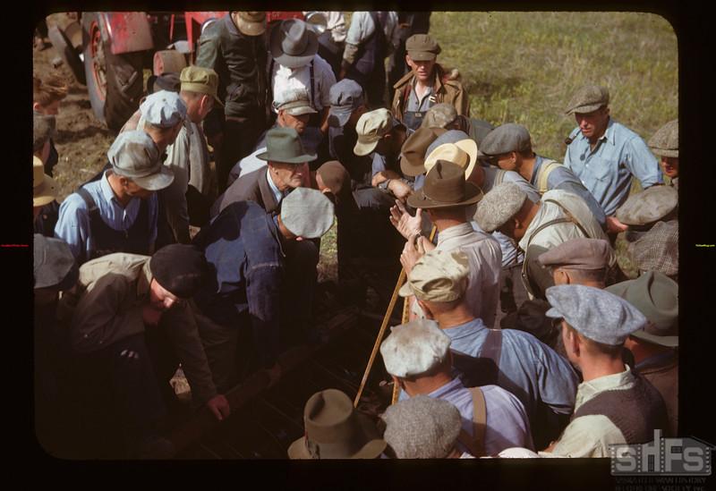 Demonstrating hitch farm machinery. Field Day Liberty 06/15/1946