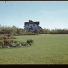 """The Big House"" and lawn - home of Supt. Jack Mac Phail - Dominion Experimental Station	 Melfort	 09/28/1946"