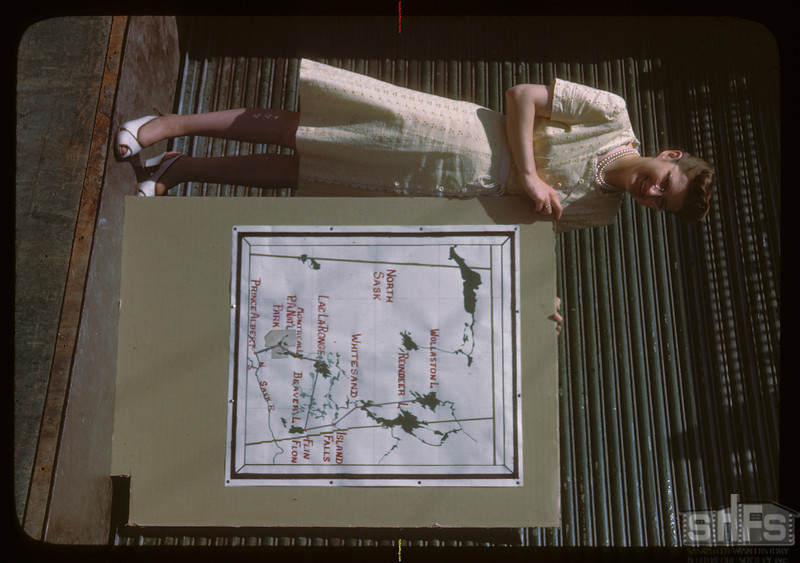 Map of Sask. and girl who made map..  Prince Albert.  06/21/1946