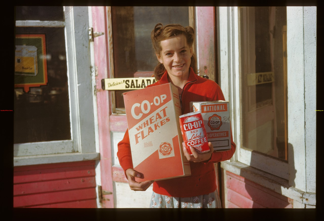 Rowena Person showing off Co-op products Fairy Glen 09/27/1946