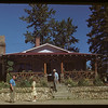"""Mrs. Crofford & Charles Mycroff and Wilf McLead standing outside """"The Residence"""" Cypress Hills 07/04/1948"""