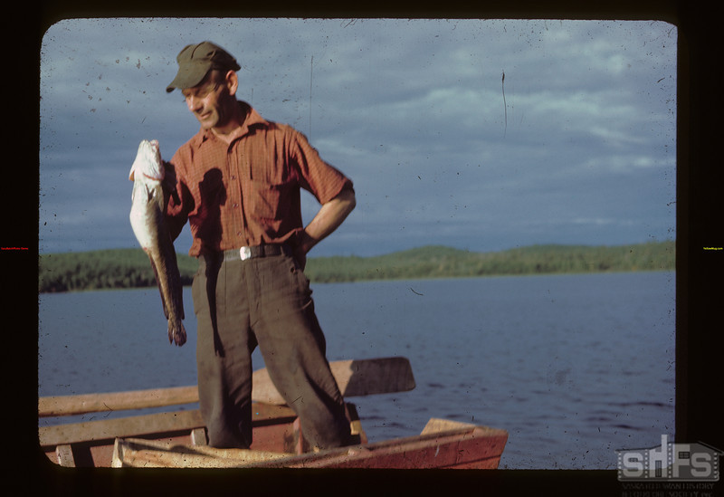 "Andy holding non-edible ""Maria"" Loon Lake 08/22/1944"