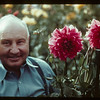 Paul Lanz with Red Dahlias	 Cochin	 08/13/1944