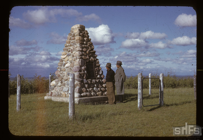 Solomon Bluehorn and L. Romto standing at Cutknife Hill Battle monument anotherv cairn was built on the battlefield site at a later date. Cypress Hills. 06/18/1942