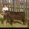 Dorothy Munn and dandy calf.	 Mankota	 06/08/1948
