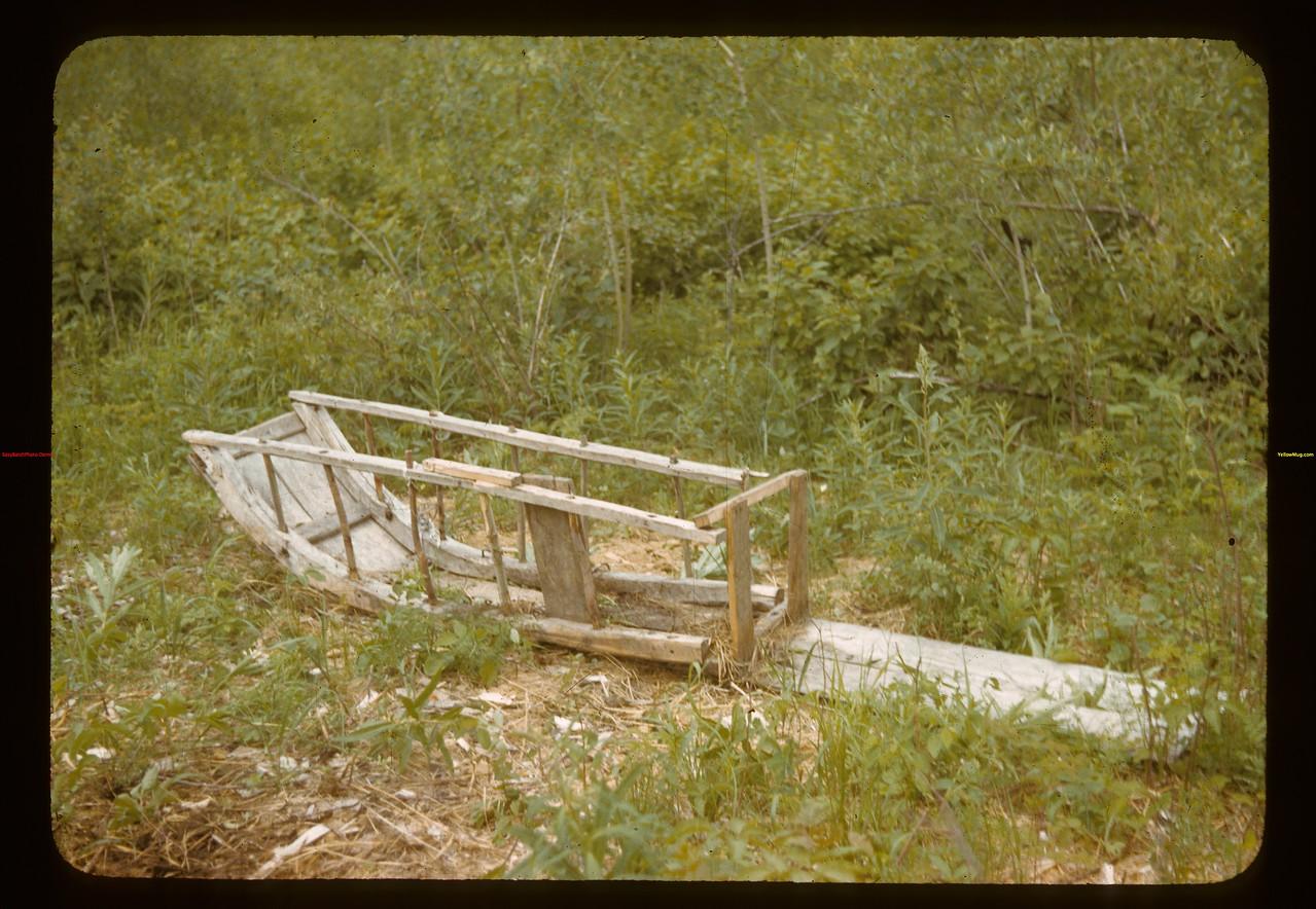 Old indian sled near cabin - north of Waterhen Dorintosh 07/08/1942